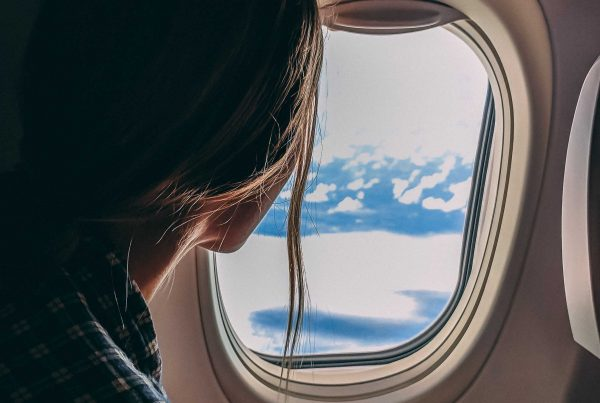 girl looking out of a plane window